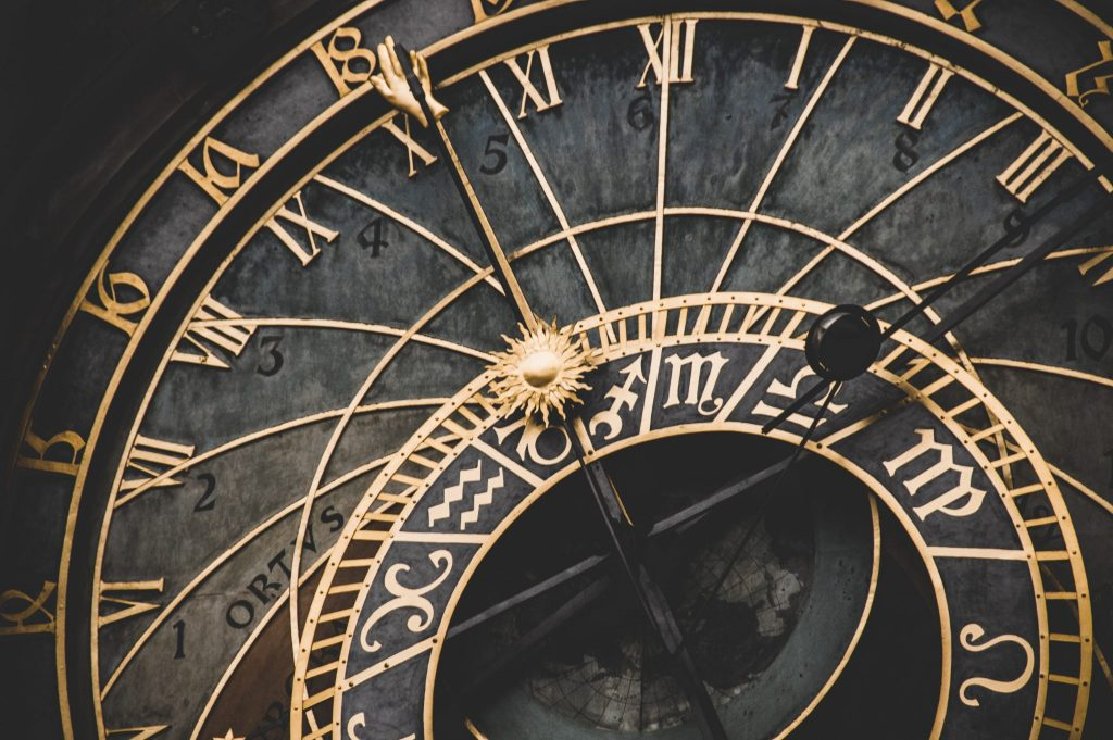 Old black & gold clock face image.
